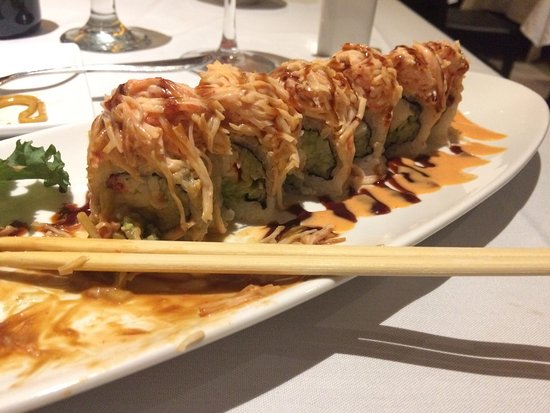 "Royersford, PA: Tiger roll~ broiled lobster, cucumber, avocado, topped with ""crab"" and special sauce."