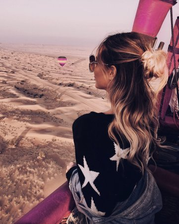 Picture yourself up in a hot air balloon above the golden dunes - Dubai