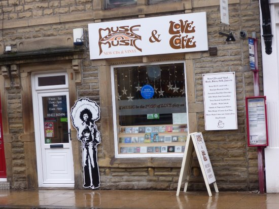Muse Music and Love Cafe: The front aspec of the establishment, love the Jimmy Hendrix cutout