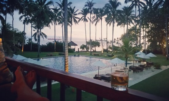 Alila Manggis: The view from our balcony over the swimming pool and beach at sunset