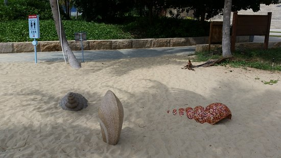 Ledong County, China: Shell sculptor at entrance to the beach