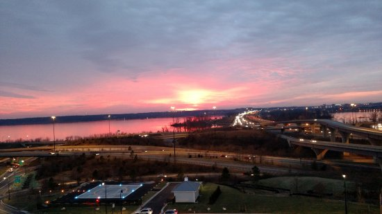 Oxon Hill, MD: A view from the outdoor terrace of the Capital Beltway and Old Town Alexandria at sunset.