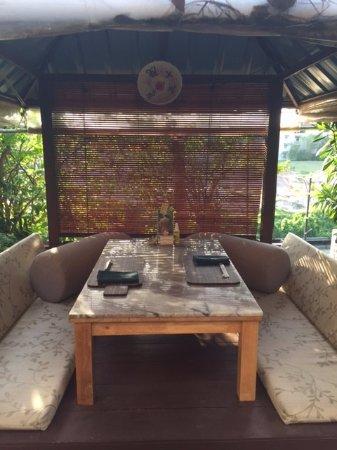 Пантай-Тенгах, Малайзия: Charming outdoor booths for two at Unkaizan