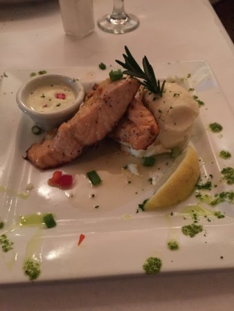 Acworth, GA: salmon stuffed with crab meat. garlic potatoes.The sauce was amazing!