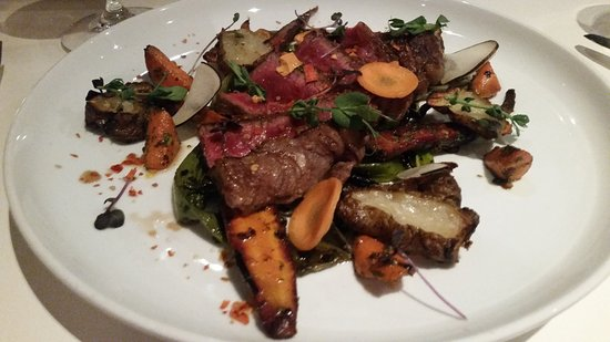 Travelers Rest, Carolina del Sur: Apple Brandy Farms Ribeye$29.00Confit Sunchoke, Roasted Heirloom Carrots, Charred Spring Onions,