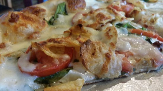 Watertown, TN: A close up of those delicious baked chips covered in cheese with tomatoes and spinach and ranch