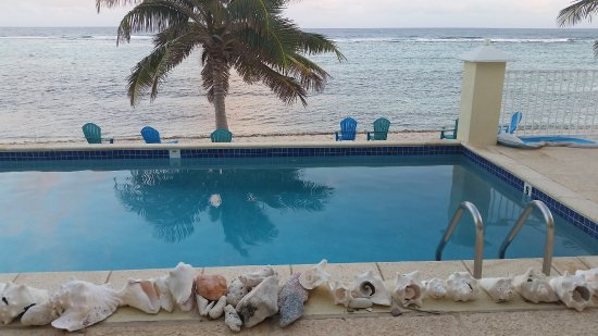 Bodden Town, Grand Cayman: View from table outside our living room at sunset