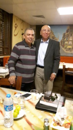 On our Balbaa village restaurant table with Major Khaled Okasha.