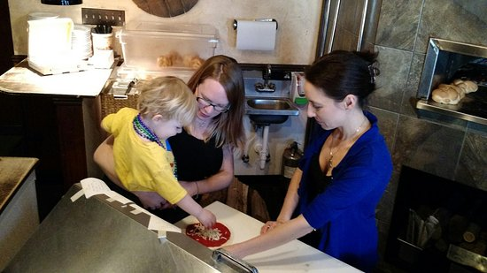 Oxford, MI: My grandson and his mother building a pizza at Italia Gardens