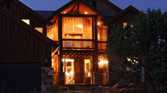 Night view of a deluxe vacation home at Zion Ponderosa Ranch Resort