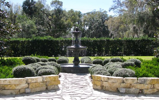 DeLand, FL: Fountain out front surrounded by manicured gardens and gazebo