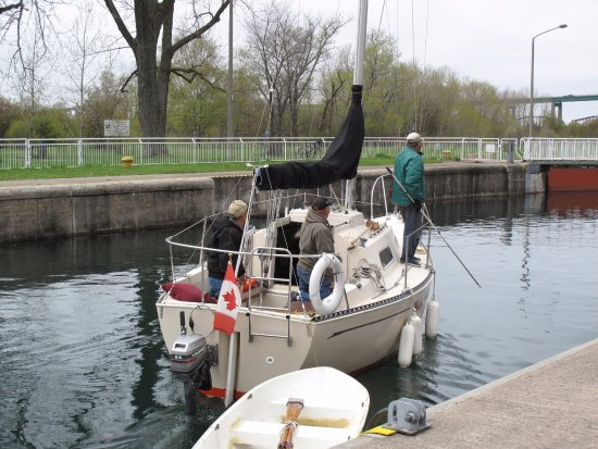 Sault Ste. Marie Canal National Historic Site: The upstream gates have now been opened and the sailboat is on its way through the lock.