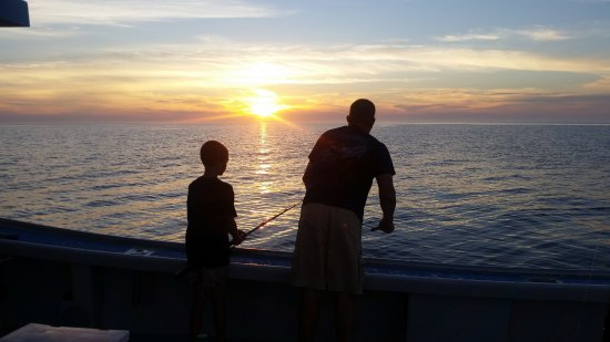 Antigonish, Canada: Capt. John and his son trying for a few more mackerel before the sun goes down.