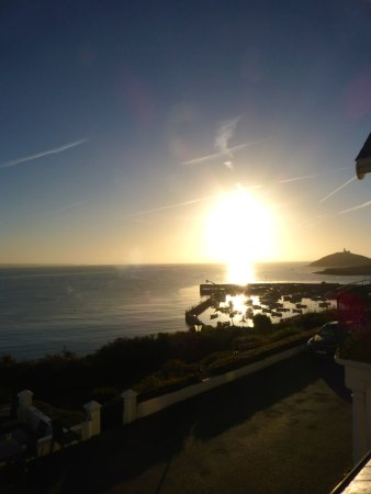 Sun rising over Ballycotton as seen from our window