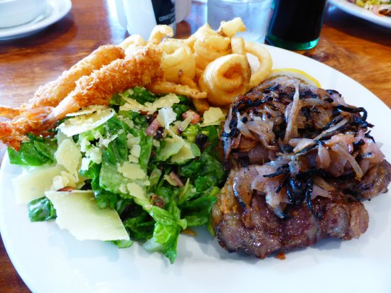 East Maitland, Avustralya: Steak with panko prawns and a side of grilled onions & caesar salad