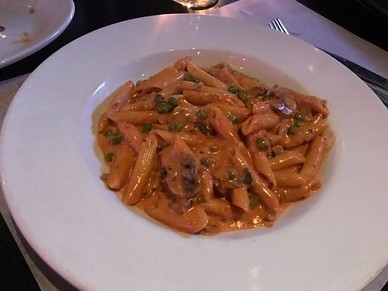 South Miami, FL: penne pasta with peas, tomatoes, mushrooms, cream and parmesan.