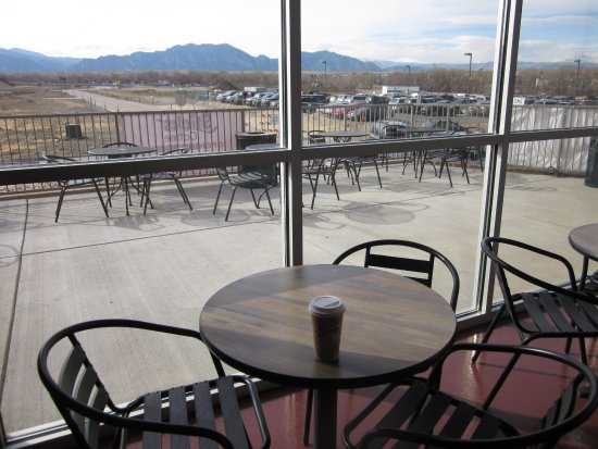 Superior, CO: View from interior table of patio and mountains.