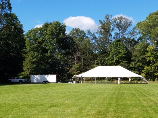 Boyne City, MI: Preparations for a summer wedding on the event lawn at Elvyn Lea