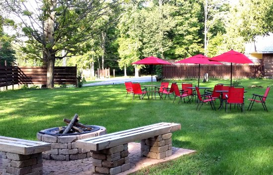 Boyne City, MI: The lower lawn with fire pit and outdoor seating.