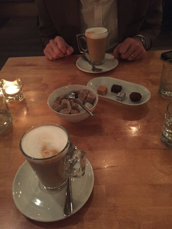 Latte and petit fours