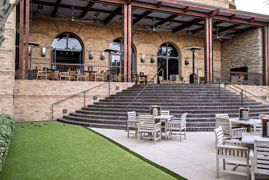 Four Seasons Resort and Club Dallas at Las Colinas: OUTLAW Taproom outdoor patio + bocce ball court