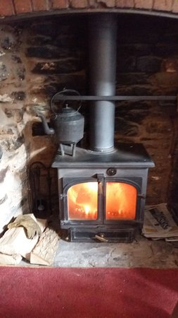 Clun, UK: Log fire - keeping the chill at bay