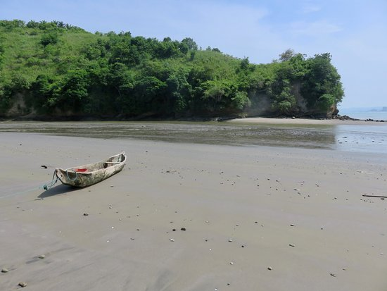 Sua, Ecuador: dugout canoe near the entrance to the mangrove swamp/lagoon