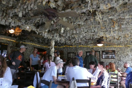 Pineland, FL: The ceilings are decked with dollar notes awaiting long returning customers.
