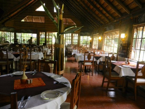 Arumeru River Lodge: The dining room. There is outdoor dining through the doors at the far end of the room.