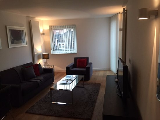 Oakwood Farringdon: Living area. Sliding door with small patio area in the back right.