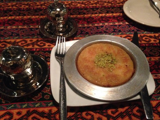 Agoura Hills, CA: Kunefe: shredded filo dough stuffed with Kurdish cheese with home made syrup and pistachios