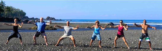 Pavones, Costa Rica : A small group of students practicing tai chi on the beach.