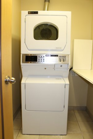 Best Western Plus King George Inn & Suites: Coin-operated guest laundry area. Open from 6:30 am-10:00 pm. Change & soap available at Front D