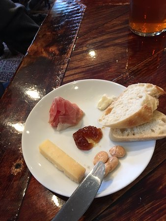 Genoa, NV: Starter cheese course with speck, cheddar, goat brie, fig jam and marcona almonds