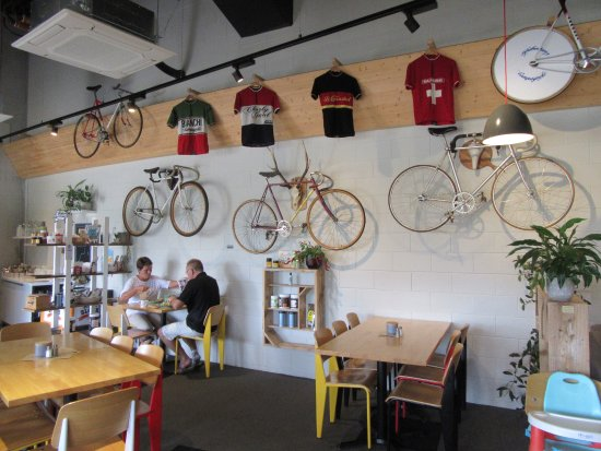Cambridge, Новая Зеландия: Showing one wall of cycles and shirts