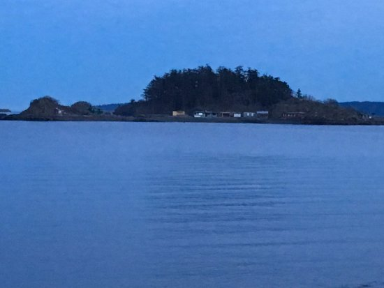 Grainy shot of Shack Island. Pipers Lagoon Park beyond...