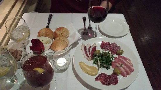 Chez Loma: A very nice red wine (their list is great!), delicious bread, and a Charcuterie plate (with duck