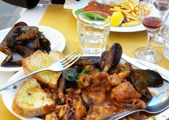 Province of Pisa, Italia: fish stew and breaded chicken with chips