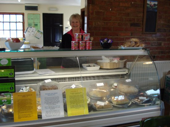 Лаут, UK: The lady with a lovely smile and home made cakes.