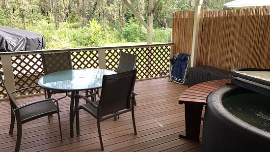 Keaau, HI: Private backyard deck with soft tub, grill and washer/dryer.