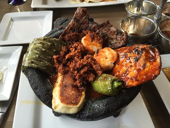Braintree, MA: Molcajete: Grilled chicken, steak, chorizo, shrimp, nopalitos, and cheese served in a roasted to
