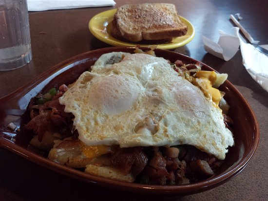Lansing, IL : all meat skillet eggs over easy wheat toast with loads of BUTTER.