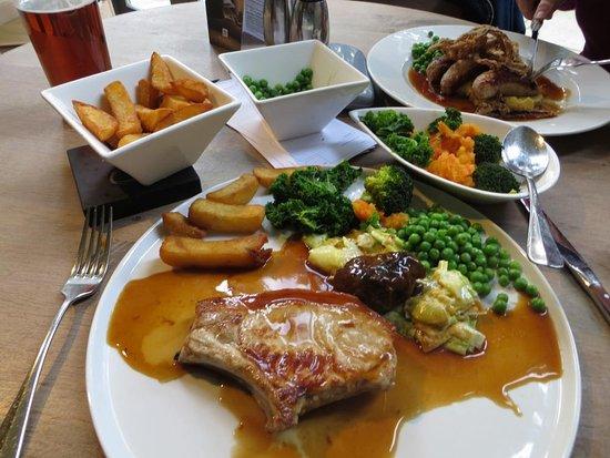 Dedham, UK: Pork chop, chips, leeks,peas, swede, broccoli & greens.