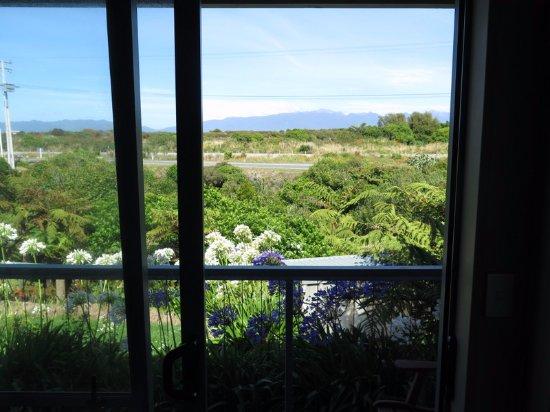 Westport, New Zealand: View out the back sliding door.