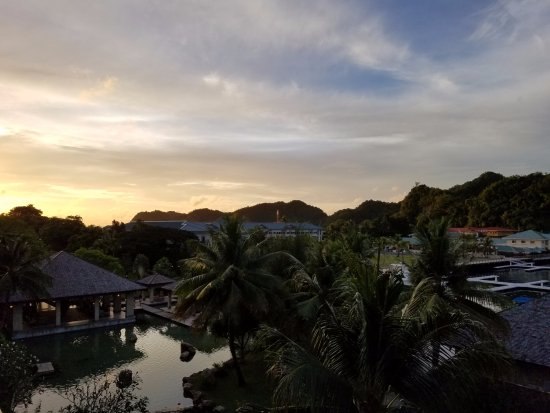 Palau Royal Resort: view from lagoon side of hotel at sunset