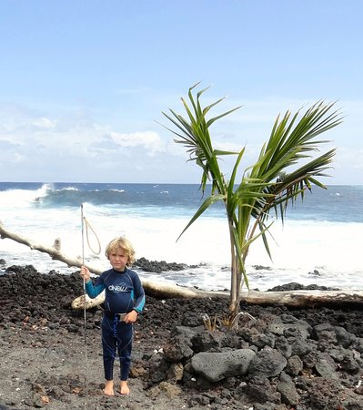 Pahoa, HI: A local fisherman. Behind him is a surf break known as Dead Trees.