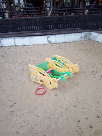 Pak Nam Pran, Thailand: Play area-- broken, tipped over, dirty, garbage and old tiles in sand