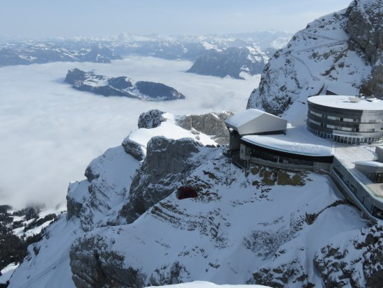 Hotel Pilatus-Kulm: View above the clouds of the arriving cable car