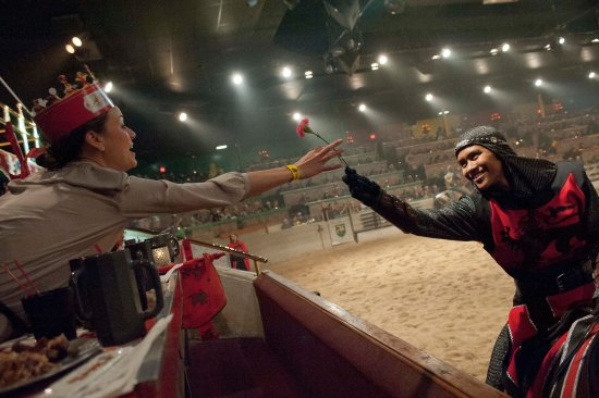 Medieval Times: The Red Knight courts a fair maiden in his cheering section.
