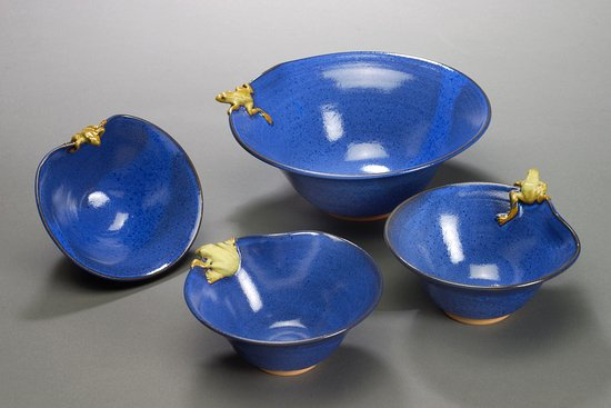 Philo, CA: Assorted blue stoneware bowls with whimsical frogs.